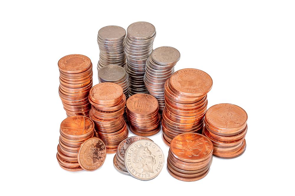 Piles of English money, 1p, 2p, 5p and 10p